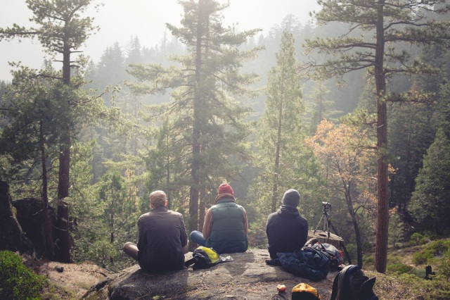 Friends resting in a forest doing outdoor sports with an app Wave Application