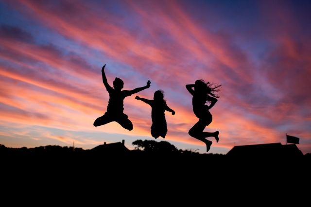 Kids jumping in the twilight